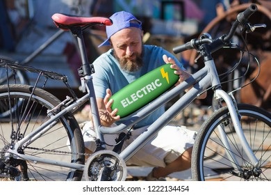 bicycle mechanic repairing and converting a bike to electric system