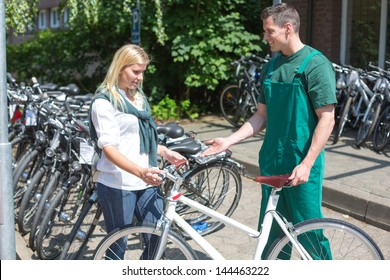 Bicycle mechanic showing a new bike to interested customer
