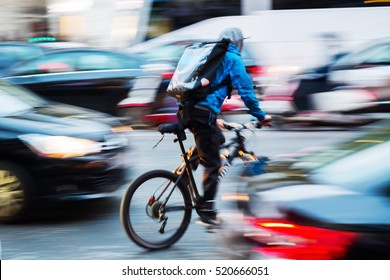 bicycle messenger in busy city traffic