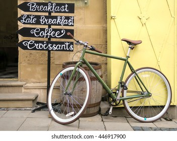 a bicycle near cafe sign