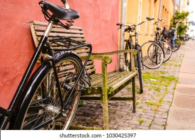 Bicycle near the colorful wall of old building in Copenhagen, Denmark. Copenhagen style, Denmark bicycle, european street