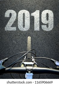 Bicycle on asphalt road. Forward to the New Year 2019.