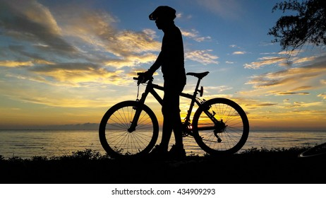 Bicycle on the beach with sunrise sky background, slow life concept, silhouette