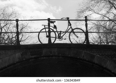 Bicycle on a bridge over a canal in Amsterdam (Black&White picture)