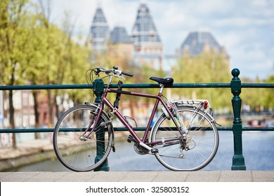 bicycle on the city street river channel bridge in Amsterdam