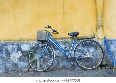 Bicycle on dirty old wall