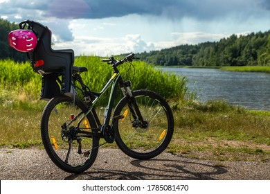 Bicycle outdoors in summer near the lake on the road