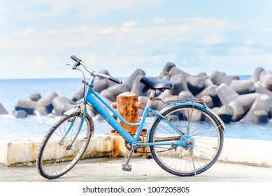 Bicycle parked  at the coast.
