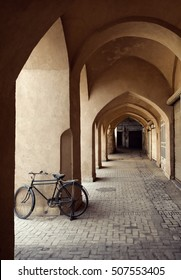 A Bicycle parked in an old passage with traditional clay arches in the city of Yazd, Iran.