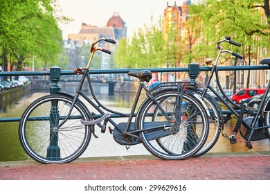 Bicycle parked on a bridge in Amsterdam, the Netherlands