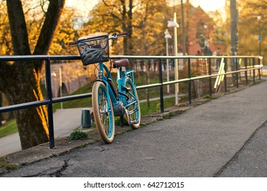 Bicycle parked on an evening street