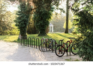 Bicycle parking in French park of Orangerie in Strasbourg on a warm summer day in April