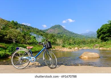 A bicycle parking on concrete bridge over the creek, Ban Khiri Wong village the favorite attraction in Tambon Kamlon, Amphoe Lan Saka, Nakhon Si Thammarat