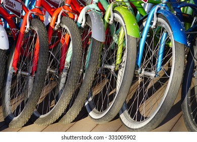 Bicycle Parking in the Park. Rent bikes in the summer. Wheel detai of a group .
