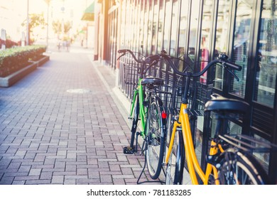 Bicycle parking at sidewalk in Japan morning day urban lifestyle transport concept.