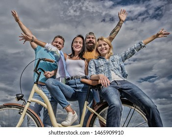 Bicycle as part of life. Cycling modernity and national culture. Group friends hang out with bicycle. Share bike live eco friendly. Company stylish young people spend leisure outdoors sky background.