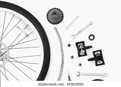 Bicycle parts and repair tools on white background