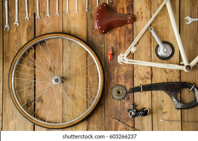 bicycle parts in a table disassembled bike