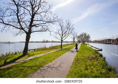 Bicycle path and footpath through water at the Reeuwijkse plassen in the Netherlands