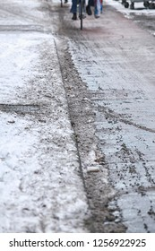 Bicycle path with melting snow