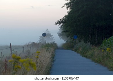 Bicycle path in morning light at the Kremersdijkje in Alteveer, the Netherlands