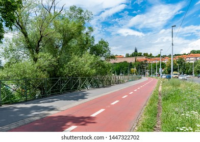 Bicycle path next to river Vltava in Prague. Summer cityscape of Prague with Vysehrad Castle in background.