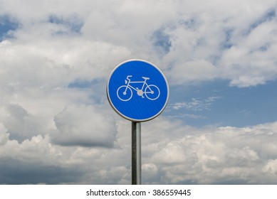"""""""Bicycle path sign in front of the clouds"""""""