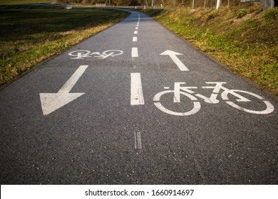 Bicycle path, two way cycling track with bicycle signs painted white