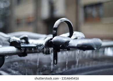 Bicycle rack on a car covered in ice after frozen rain phenomenon