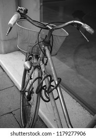 Bicycle reflected in a shop window. Black and white photo.