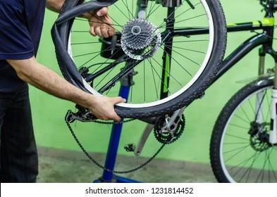 bicycle repair. mountain bike in the workshop. tire change