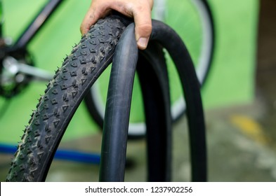 Bicycle repair. Rear wheel tube requires replacement. Mechanic set to work