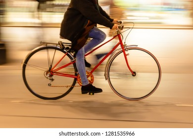 bicycle rider in the city at night, with camera made motion blur effect