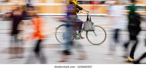 bicycle rider in the rainy city, picture made with motion blur effect