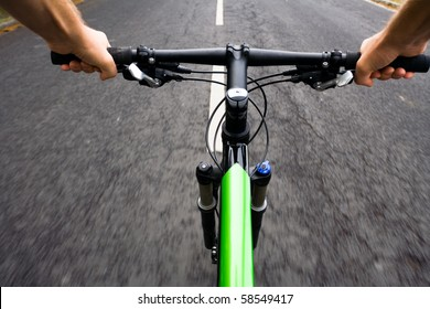 Bicycle rider riding real fast on mountain bike, motion blur