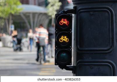 Bicycle riders waiting for traffic light sign to allow crossing street