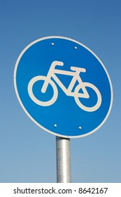 Bicycle road sign against clear blue sky