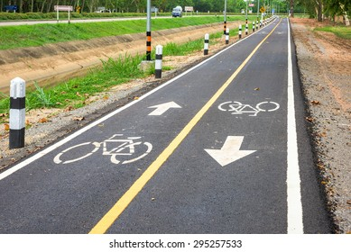 Bicycle road sign on asphalt.