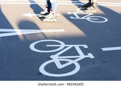 Bicycle road sign on the road with roller in motion