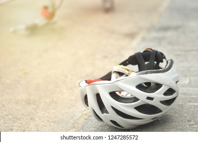 Bicycle safety helmets was left on the street after The bike was hit by a car. Injured. Close up bicycle helmets