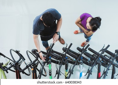 Bicycle salesman Helping customers buy a bike in a shop.top view