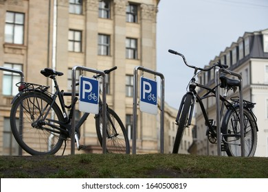 Bicycle secured on a parking in a city.