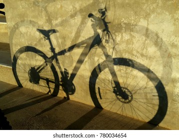 bicycle shadow on concrete background