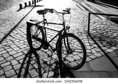 Bicycle with shadows, black and white photo
