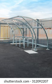 Bicycle shelter made from galvanised steel and perspex with bike racks