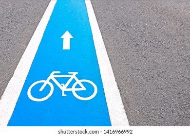 Bicycle sign or icon on the road in the park, symbol Bicycle shape, concept, exercise and health