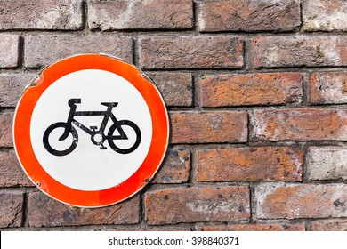 bicycle sign on brick wall