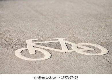 Bicycle sign on road. Bike lane sign - only bikes allowed. Road marking on park asphalt