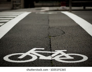 Bicycle sign on the road used for pedestrian crossing