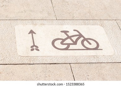 Bicycle signs on the bicycle way in Park. Bicycle lane for bike rider. Cycling path in the city. Bicycle road sign